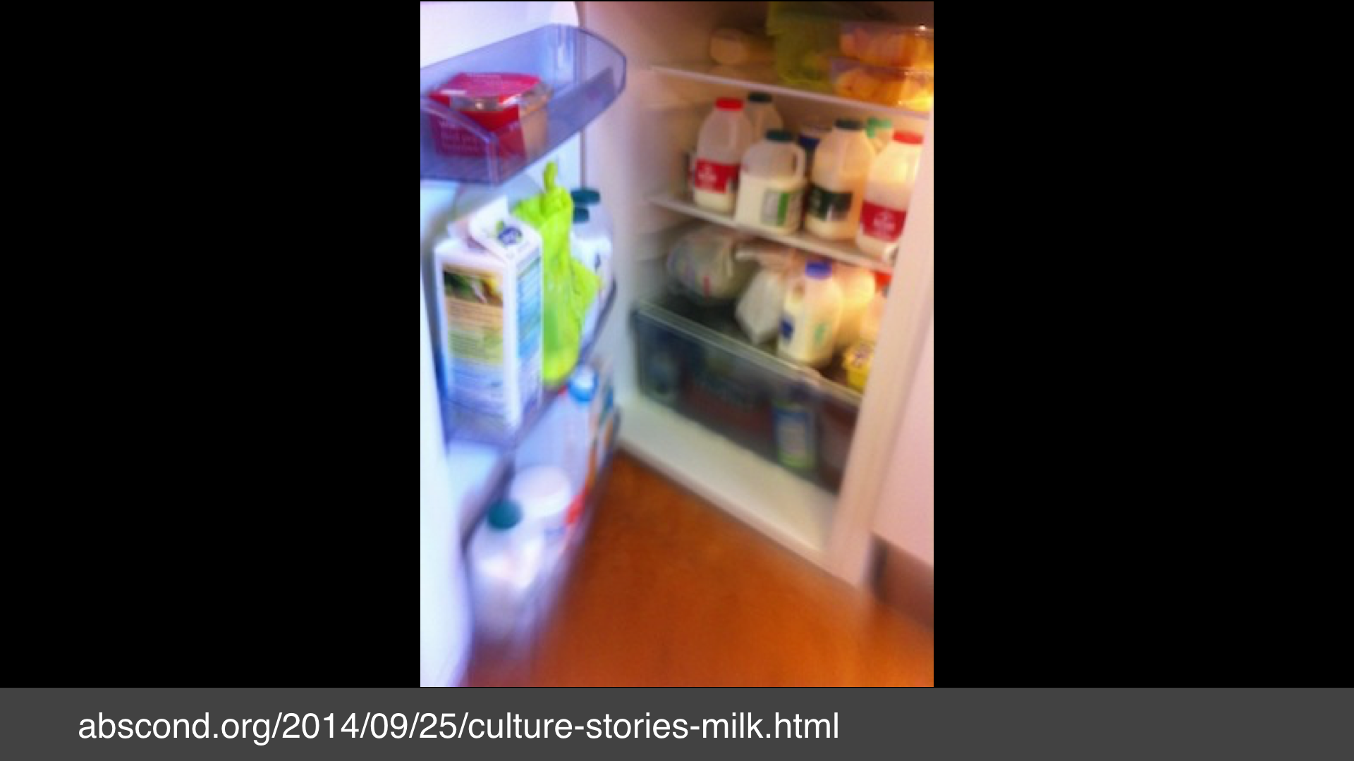 A photo of a fridge full of small bottles of milk