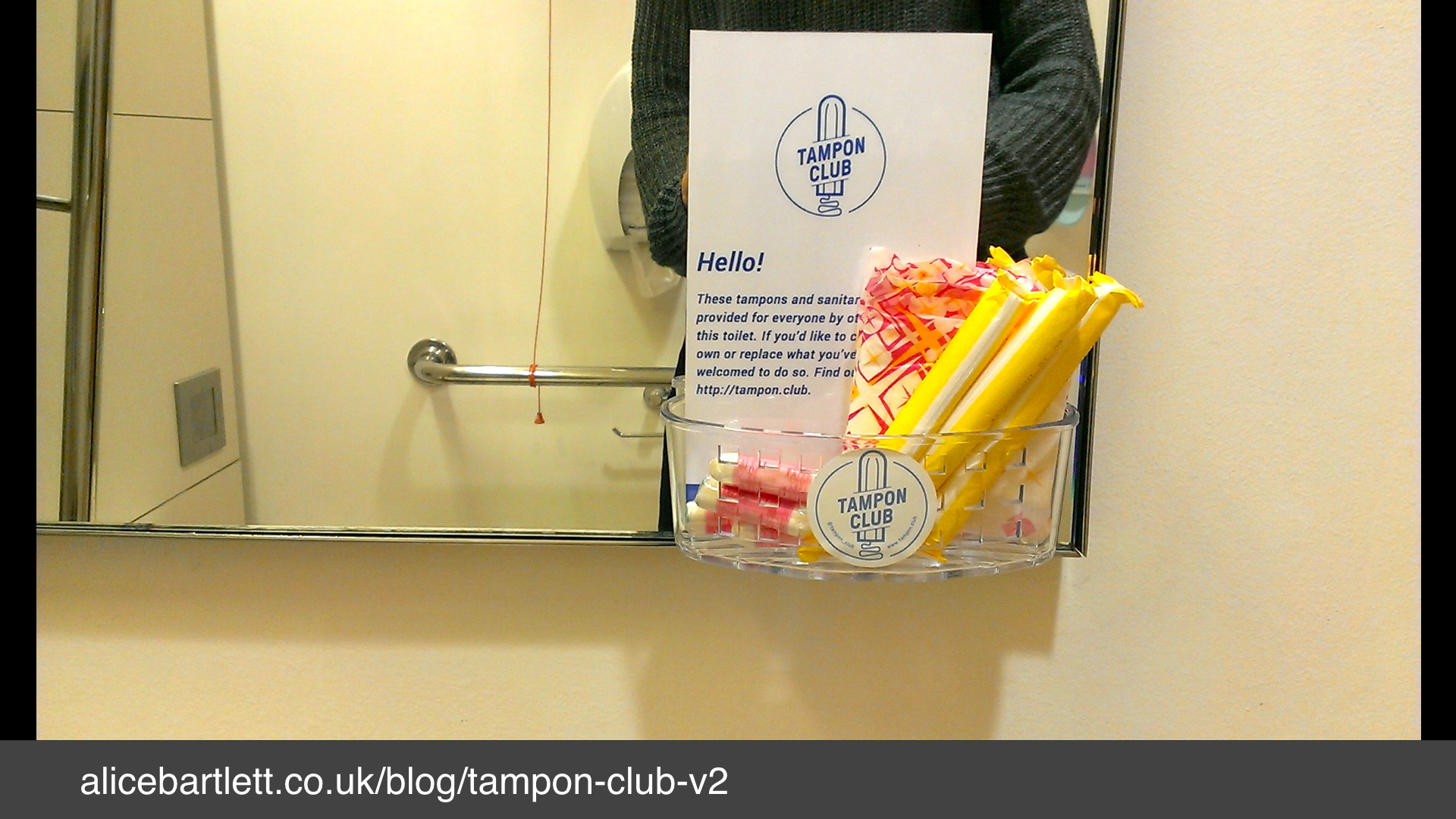 A photo of a nicely labelled basket of tampons in a bathroom